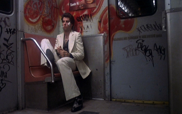 Saturday-Night-Fever_John-Travolta_white-suit-train-smoking.bmp-1