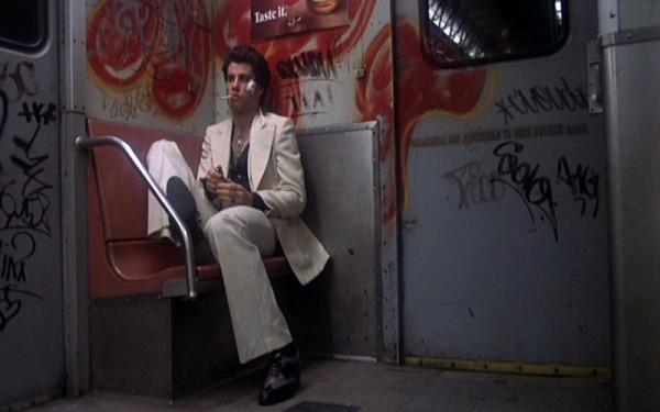 Saturday-Night-Fever_John-Travolta_white-suit-train-smoking.bmp-1