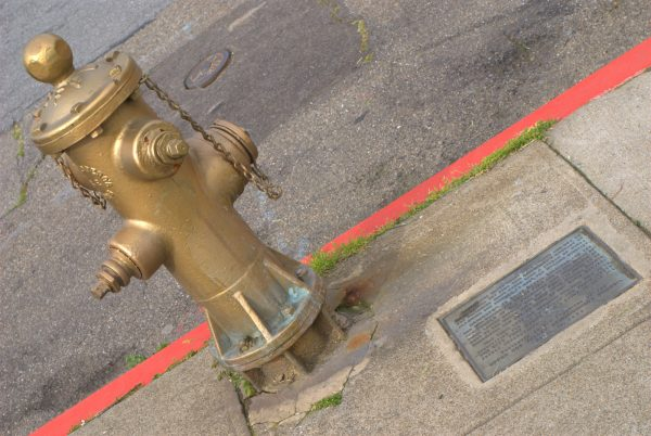 Golden fire hydrant and plaque by Ed Bierman