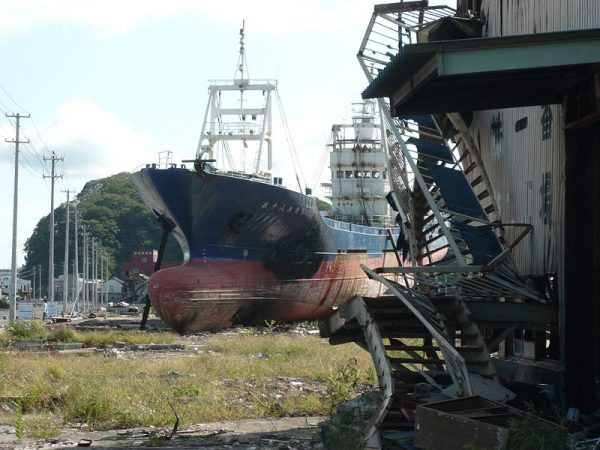Ghost town in Japan with boat washed ashore in 201, image by Tamaki Seto (CC BY-SA 3.0)