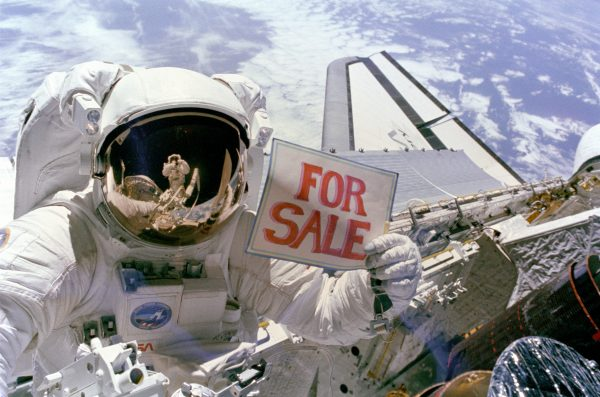 NASA astronaut jokingly advertises a recovered defective satellite for sale during a space walk