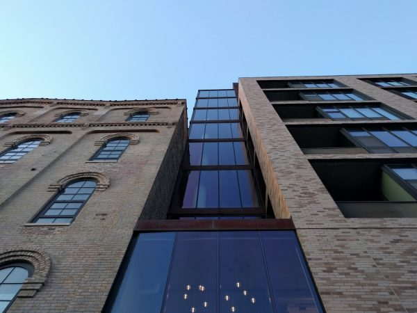 New Humbolt Lofts (right) next to historical Mill City Museum (left) in Minneapolis, Minnesota, image by Kurt Kohlstedt