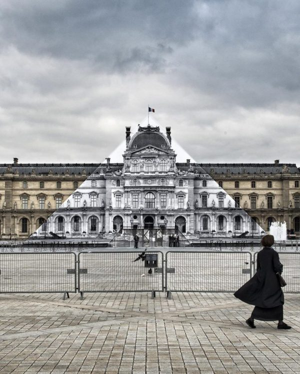 Louvre art project by French artist JR, camouflaging the glass pyramid