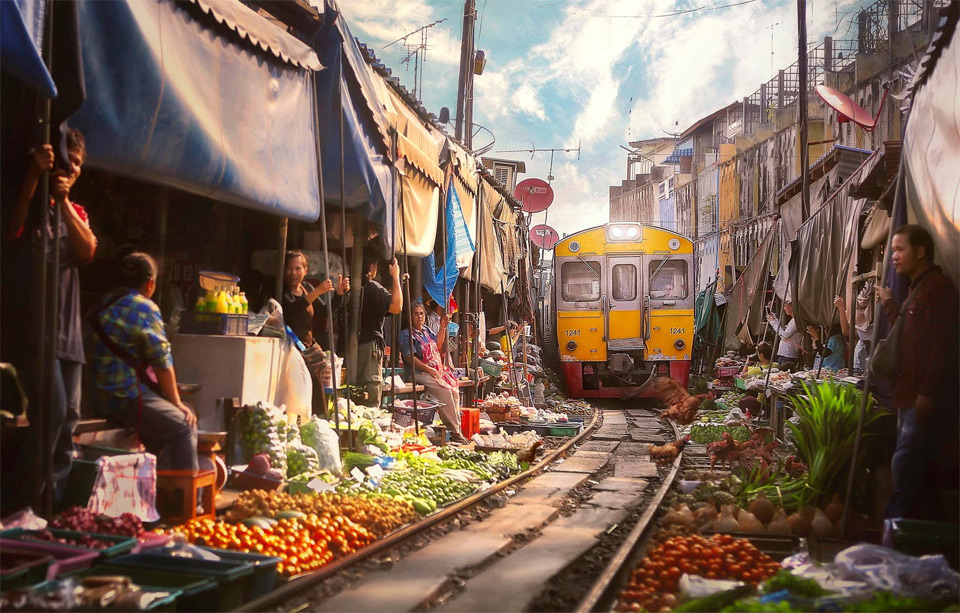 railway market urban train track doubles as shopping alley in